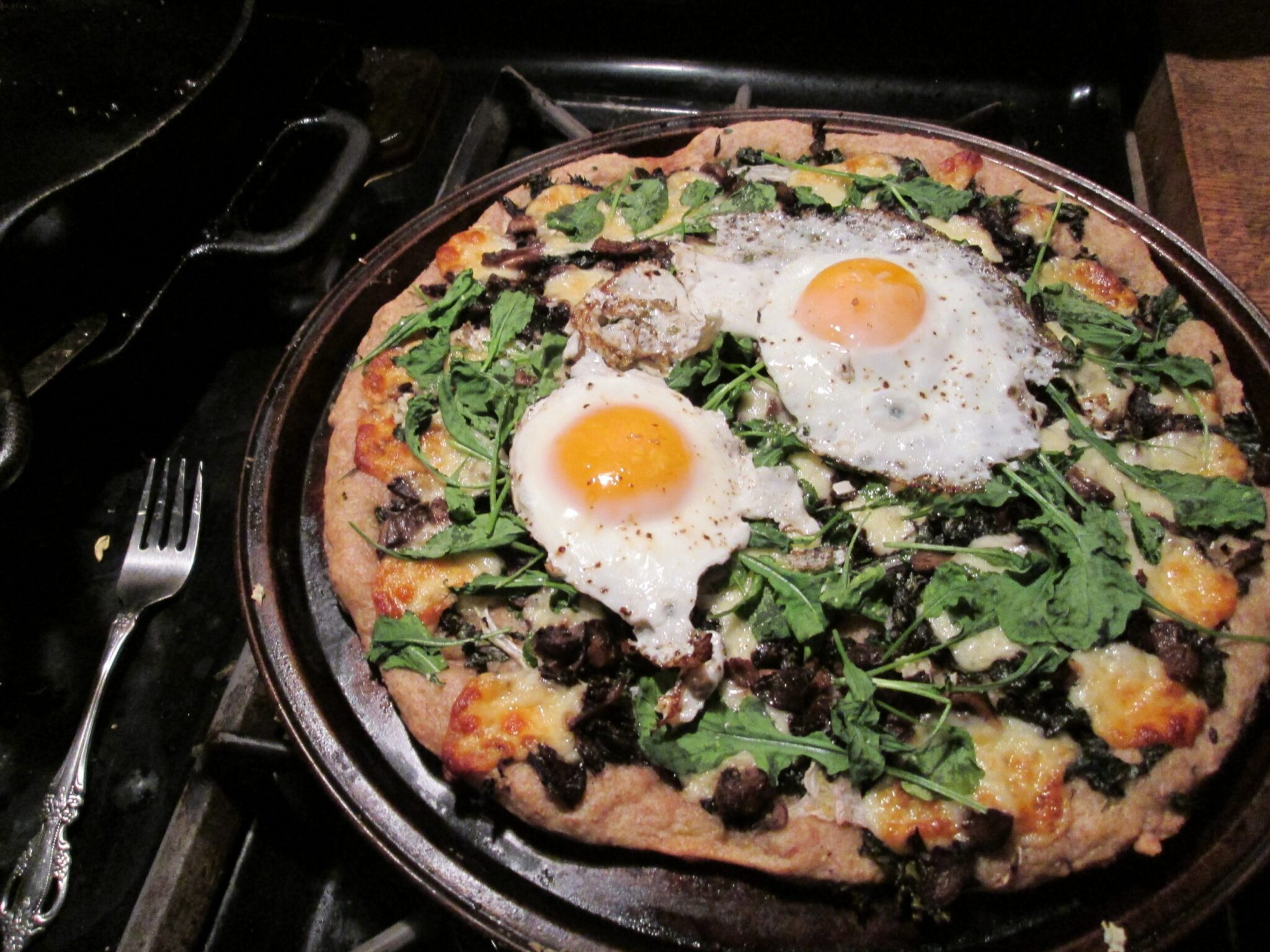 Two-egg pizza, with arugula and oyster mushrooms and a multi-grain crust.  Nom!